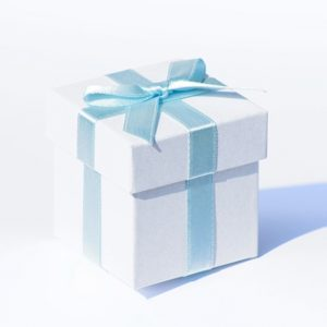 White Pearlised Box With Baby Blue Ribbon And Tissue PaperWhite Pearlised Box With Baby Blue Ribbon And Tissue Paper