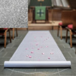 White Aisle runner with a floral lace designWhite Aisle runner with a floral lace design