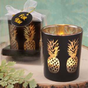 Matte black glass candle holder with shimmering gold pineapplesMatte black glass candle holder with shimmering gold pineapples