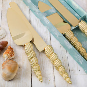 Conch sea shell design Knife and server setPlanning a sea themed or beach themed event, party or grand occasion? This exquisite knife and server set will be the perfect utensils to cut your cake. They also make meaningful favors to offer to guests as a welcome gift.