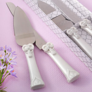 Cross and heart design Knife and server set from fashioncraftWhen Love and Faith combine at your celebration, this the perfect knife and server set to cut your cake! The set also makes a meaningful favor to offer to guests as a Thank You gift.