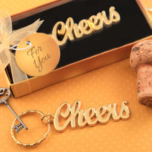 Metal Cheers themed keychain with a gold finishMetal Cheers themed keychain with a gold finish
