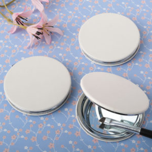 Perfectly plain white leatherette hinged mirrorPerfectly plain white leatherette hinged mirror