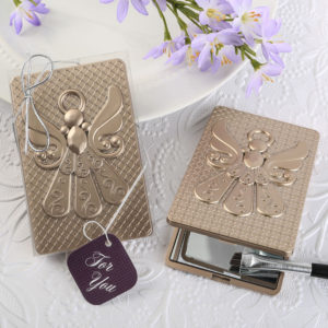 Angel themed mirror compact with a champagne gold finishAngel themed mirror compact with a champagne gold finish