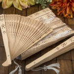 Pack of 10 Intricately carved Sandalwood fan favors from solefavorsPack of 10 Intricately carved Sandalwood fan favors from solefavors